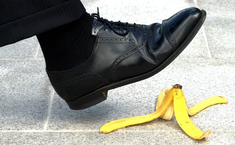 A man, about to step on a banana peel