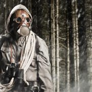 A Doomsday Prepper With Gas Mask and Guns