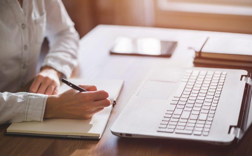 A man at a desk, writing